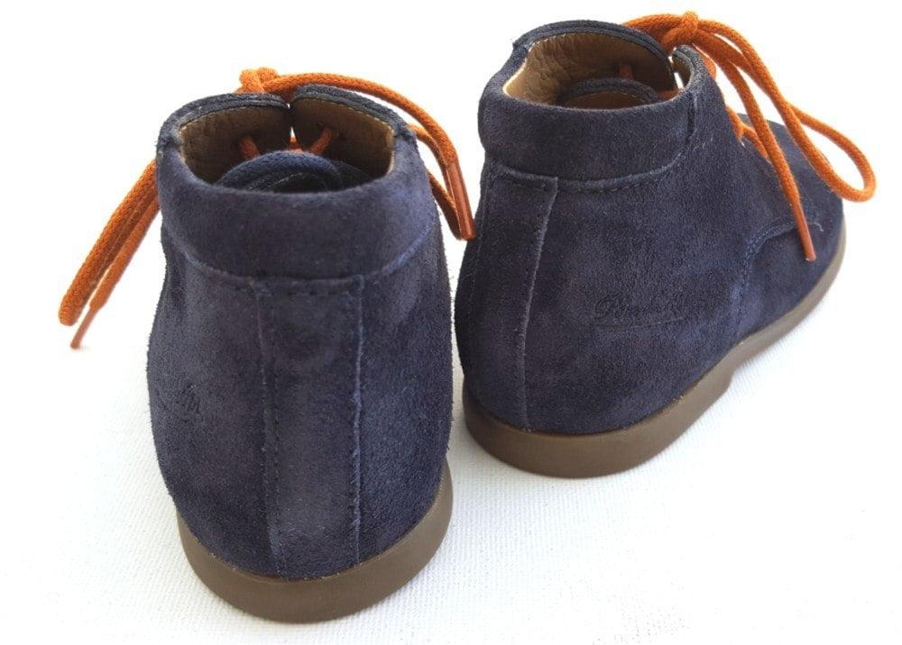 Bottillon premiers pas en cuir velours marine avec 2 lacets marine ou orange, modèle Nioupi Derby Velours signé Pom d'Api