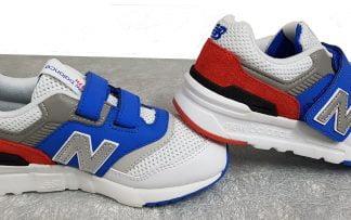 une ligne audacieuse et branchée pour la basket enfant New Balance PZ997 HZJ bklanche, bleue, rouge, grise et noire fermée par 1 velcro